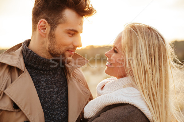 Close up portrait of a good looking couple in love Stock photo © deandrobot