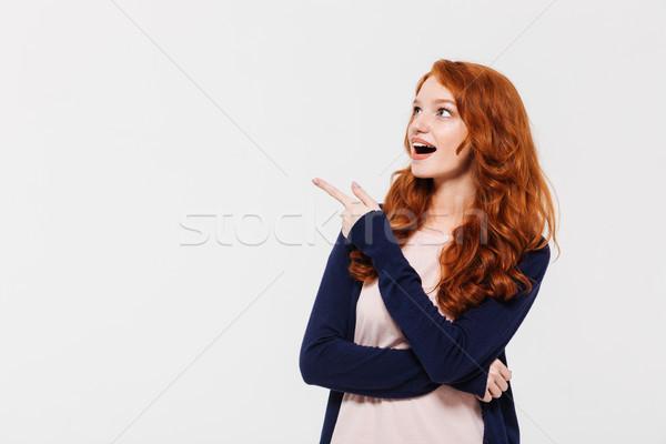 Uimit tineri doamnă îndreptat imagine Imagine de stoc © deandrobot