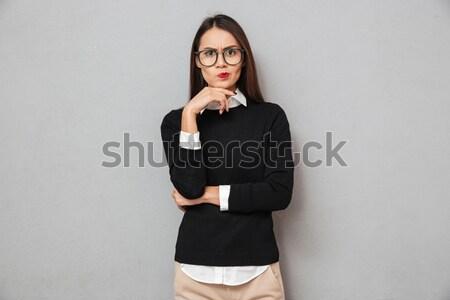 Grave pensieroso asian donna business vestiti Foto d'archivio © deandrobot