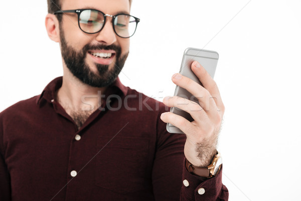Close up portrait of a cheerful young man in eyewear Stock photo © deandrobot