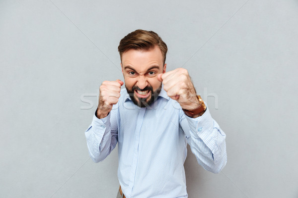 Angry bearded man in business clothes ready to fight Stock photo © deandrobot