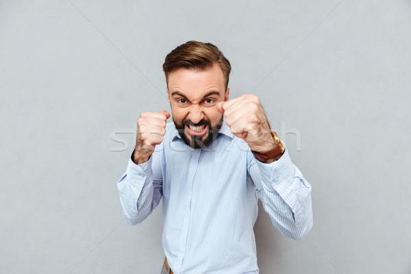 Böse bärtigen Mann Business Kleidung bereit Stock foto © deandrobot