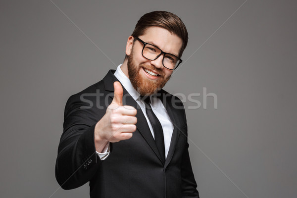 Portrait of a smiling young businessman dressed in suit Stock photo © deandrobot