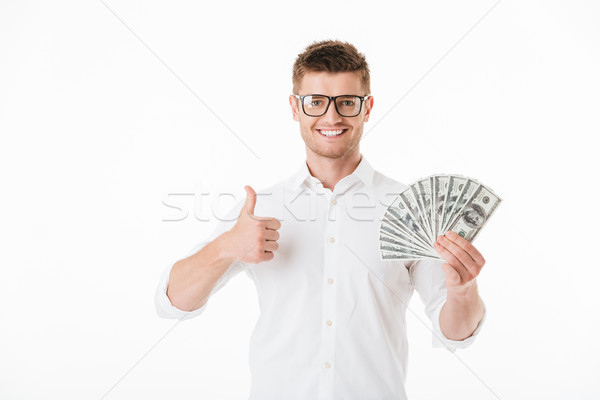 Portrait of a confident young man in eyeglasses Stock photo © deandrobot