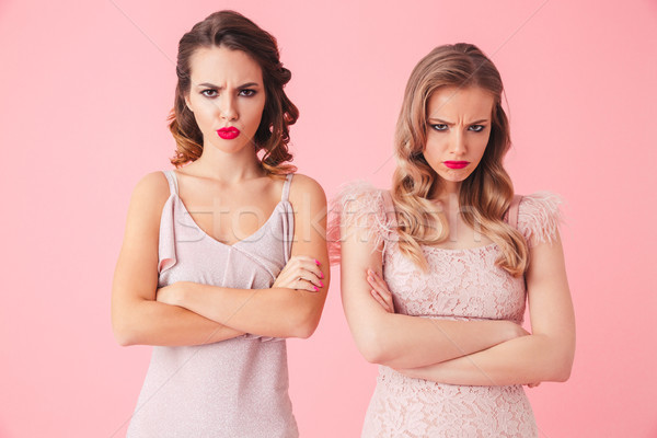 Two serious displeased women in dresses looking at the camera Stock photo © deandrobot