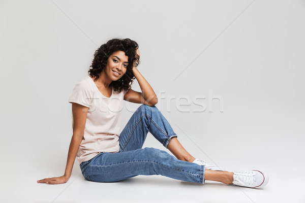 Portrait of happy young afro american woman resting Stock photo © deandrobot