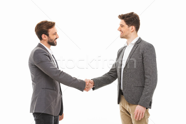 Portrait of a two satisfied business men shaking hands Stock photo © deandrobot