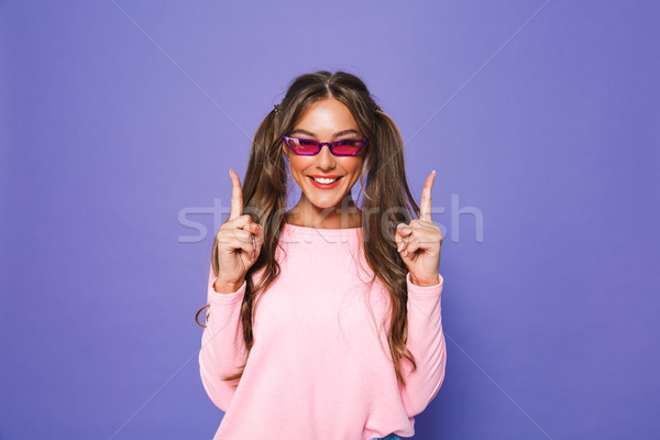 Portré elégedett lány pulóver napszemüveg néz Stock fotó © deandrobot