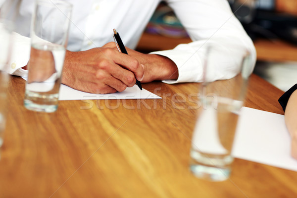 Closeup portrait of a male hand writing on a paper Stock photo © deandrobot