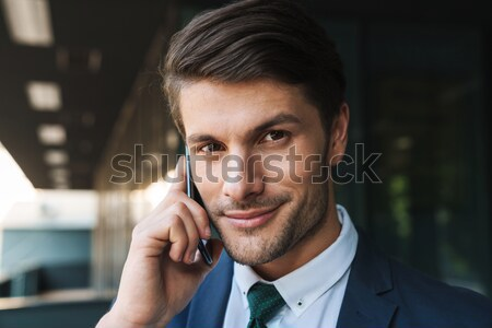 Portrait of a confident serious businessman Stock photo © deandrobot