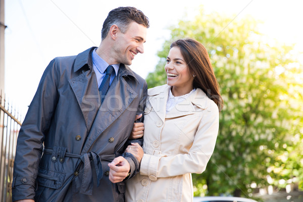 Happy young couple walking outdoors Stock photo © deandrobot