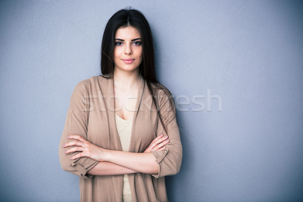 Portrait of attractive young woman with arms folded Stock photo © deandrobot
