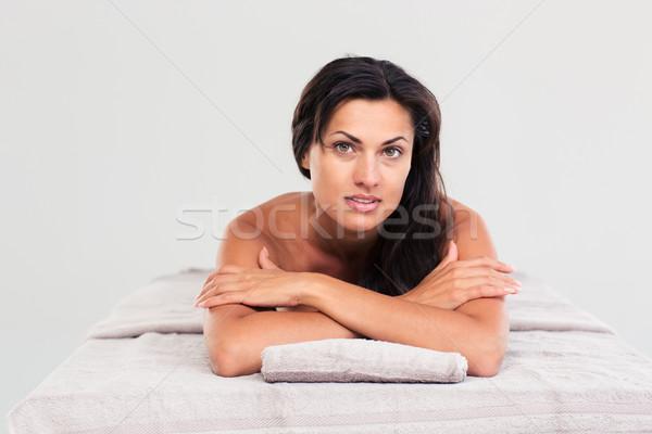 Woman lying on massage lounger  Stock photo © deandrobot
