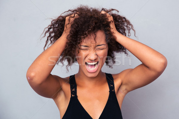 Portrait of afro american woman shouting  Stock photo © deandrobot