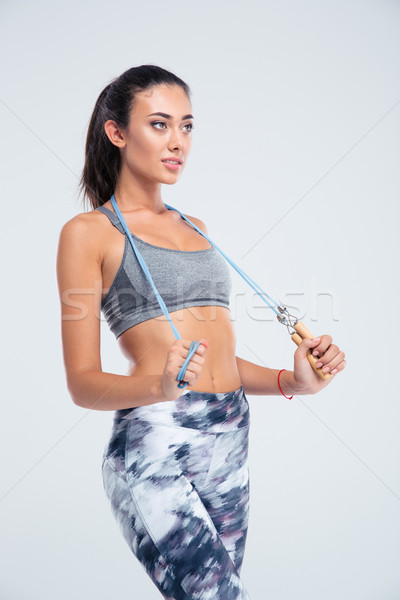 Portrait of a happy sports woman with skipping rope  Stock photo © deandrobot