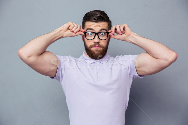 Amazed casual man looking at camera Stock photo © deandrobot