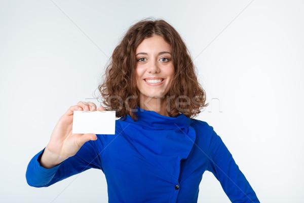 Portre gülümseyen kadın boş kart yalıtılmış beyaz Stok fotoğraf © deandrobot