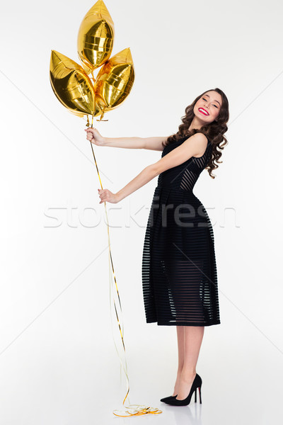 Amusing positive lovely female posing with star shaped balloons Stock photo © deandrobot
