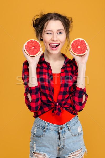Stockfoto: Koket · glimlachende · vrouw · poseren · grapefruit · glimlachend