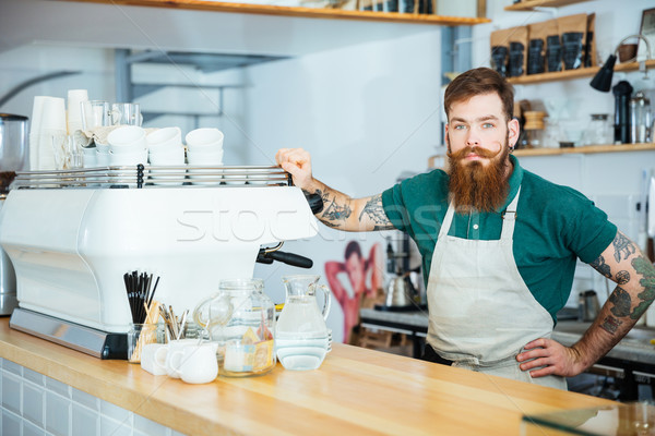 Portrait of barista standing near coffe machine in coffee shop Stock photo © deandrobot