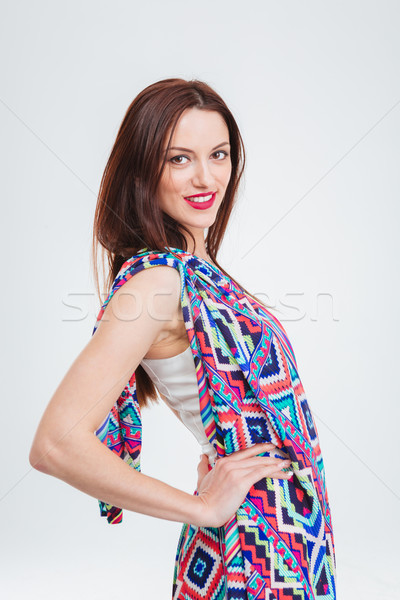 Beautiful smiling young woman in colorful sundress  Stock photo © deandrobot