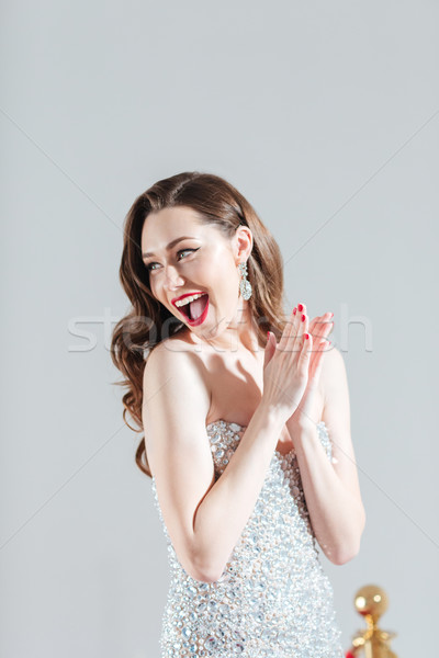 Cheerful fashion woman clapping hands Stock photo © deandrobot