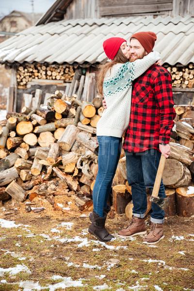 Heureux femme bel homme ax village Photo stock © deandrobot