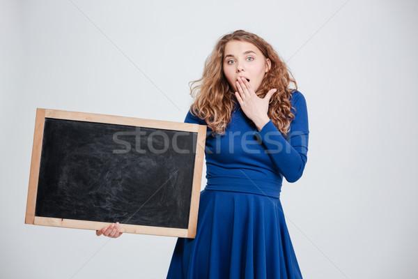 Meglepett nő tart befogja száját izolált fehér Stock fotó © deandrobot