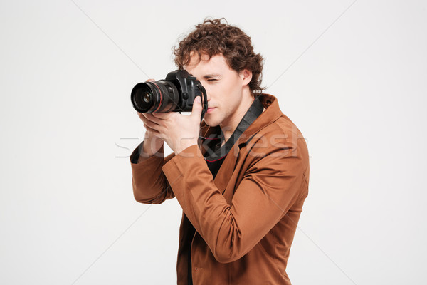 Male photographer with camera Stock photo © deandrobot