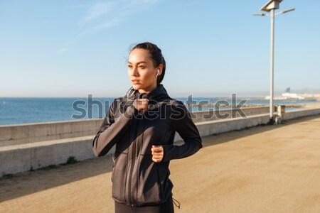 スポーツマン イヤホン 立って 桟橋 音楽を聴く 深刻 ストックフォト © deandrobot
