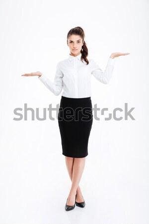 Belo jovem empresária em pé cópia espaço Foto stock © deandrobot