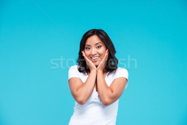 Meglepett ázsiai csinos nő áll izolált kék Stock fotó © deandrobot
