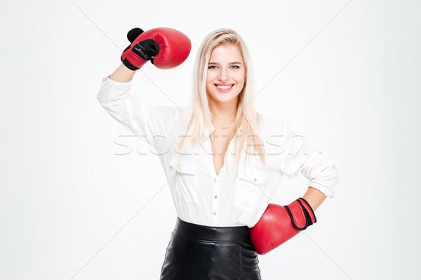 幸せ 小さな 女性実業家 ボクシンググローブ 上腕二頭筋 ストックフォト © deandrobot