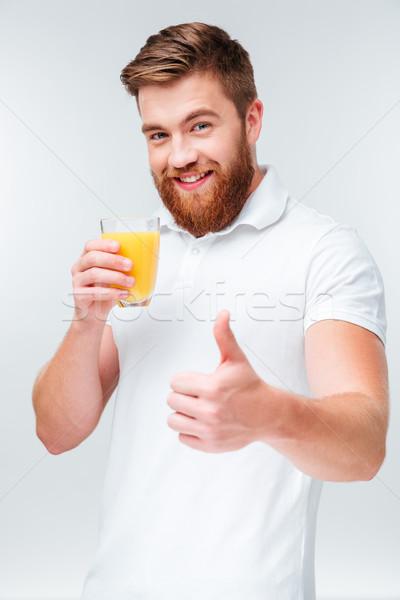 男 ガラス オレンジジュース ストックフォト © deandrobot