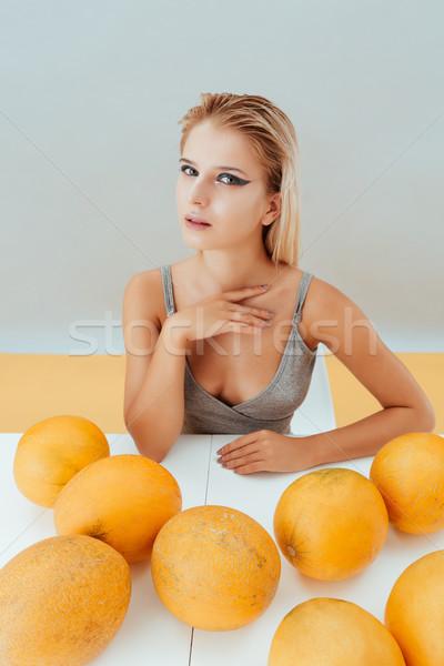Portre güzel bir kadın oturma tablo güzel genç kadın Stok fotoğraf © deandrobot