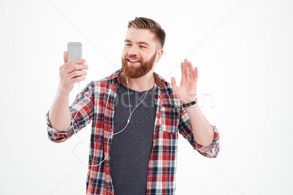Gelukkig bebaarde man mobiele telefoon Stockfoto © deandrobot