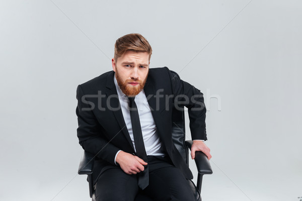 Business man on armchair Stock photo © deandrobot