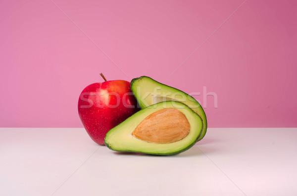 Pomme rouge avocat isolé rose fruits Photo stock © deandrobot