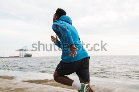 Runner tying shoelaces on beach Stock photo © deandrobot
