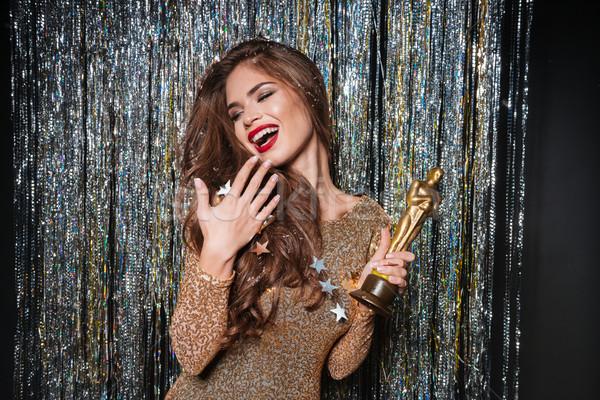 Feliz mulher jovem vestido de noite risonho prêmio Foto stock © deandrobot