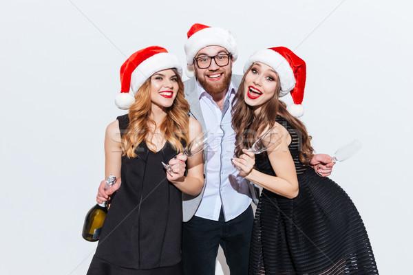 Trois souriant personnes bouteille Photo stock © deandrobot