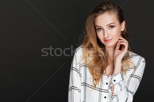 Hermosa dama posando oscuro foto jóvenes Foto stock © deandrobot