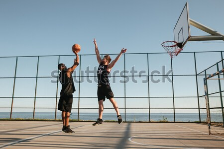 Two sportsmen playing basketball Stock photo © deandrobot
