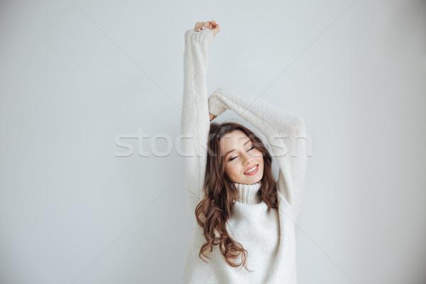 ストックフォト: きれいな女性 · セーター · スタジオ · 孤立した
