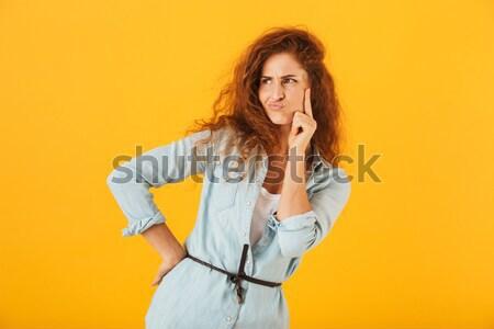 Portré fiatal töprengő nő másfelé néz copy space Stock fotó © deandrobot