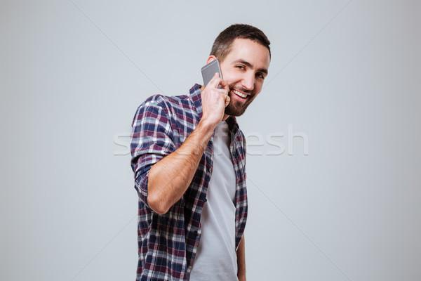 Barbado hombre camisa hablar teléfono mirando Foto stock © deandrobot