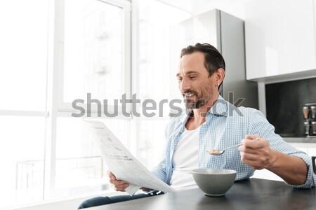 молодые бородатый человека питьевой кофе говорить Сток-фото © deandrobot