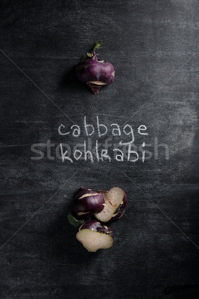Image of cabbage kohlrabi over dark background. Stock photo © deandrobot