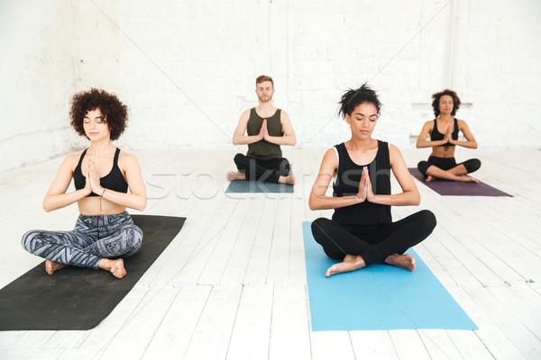 Csoportkép jóga tornaterem ül képzés csoport Stock fotó © deandrobot
