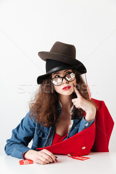 Sale shopping woman with sale signs sitting at the table Stock photo © deandrobot